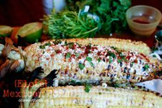 Authentic Mexican Corn {Elote}. Grilled corn smothered in Mexican Crema, sprinkled with Cotija (a dry mexican cheese), a little smoky Paprika and fresh Cilantro, and you have corn thats loaded with tons of flavor! ohsweetbasil.com