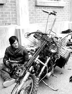 Daryl and his bike with his poncho