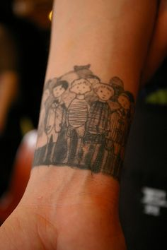 I adore this Edward Gorey wristband tattoo.