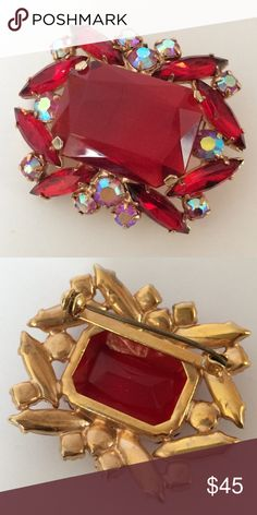 "Vintage Gorgeous Ruby Red Rhinestones Gold Brooch Vintage ruby red and aurora borealis art glass rhinestones set in gold plated pin. Largest stone is open back. Sparkles in every direction. Minor wear as shown. Unsigned. Measures 2"" wide. Vintage Jewelry Brooches"