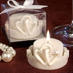 Interlocking Hearts Candles (FashionCraft 8304) | Buy at Wedding Favors Unlimited (http://www.weddingfavorsunlimited.com/interlocking_hearts_candles.html).