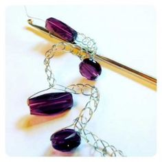 Crocheting with wire and beads.