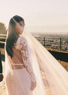 Kim Kardashian wore a couture wedding dress by Givenchy boasting intricate lace long sleeves.