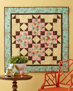 Fall in love with this wall hanging featuring pretty pastels and romantic florals. Scrappy 36-Patch blocks and strategic sashing jump off a cream quilt center.