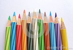 Color Pencils arranged side by side on white paper.