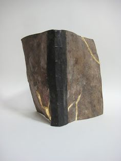 Book art by Marc Cockram Taking inspiration from ... the art/craft of the repair of ceramics with lacquer and powdered gold - Kintsugi ( golden joinery ) some times also referred to as Kintsuuroi ( golden repair )