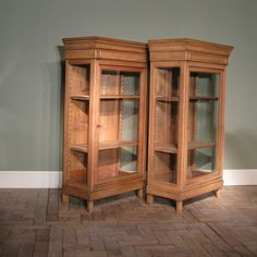 A useful pair of late 19th century French, bleached Oak display cabinets/ bookcases, with adjustable shelves, retaining the original glass, and of small proportions, that will work well in small spaces. www.brownrigg-interiors.com