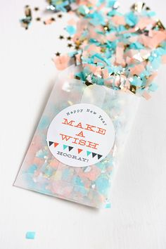 It's almost time to ring in the new year! Make a wish and ooh rah, rah into the new year with these DIY New Year's confetti favors by Evermine Occasions. To start, all you need is tissue paper in a variety of colors and a pair of scissors. Get crafty!