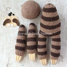 "Sew cute & sluggish looking sock sloth, Smie. It is 16"" long sewn from chenille socks, with 3 claws on each limb, big groggy eyes & a sweet smile."