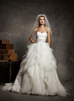 Justin Alexander wedding dresses style 8640 Strapless sweetheart pleated asymmetrical bodice, accented with a 4-inch beaded belt at natural waist, mille-feuille organza full skirt, buttons over back zipper, chapel length train.