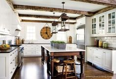 Love the dark wood with white cabinets