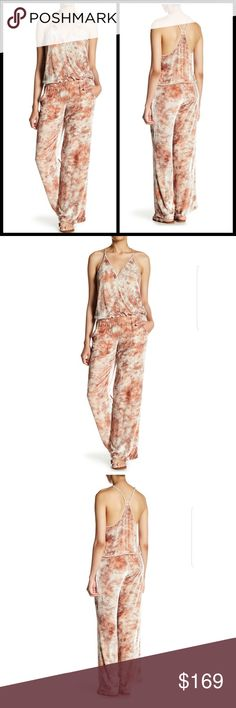 """Young Fabulous & Broke Peach Cloud Naomi Jumpsuit 🍑NWT! This stunning Young Fabulous & Broke Velvet Jumpsuit in """"Peach Cloud"""" takes the best of current trends & makes it comfortable & versatile to wear in this luxe jumpsuit. Fitted hip w/ loose leg & adjustable top. Deep V has a hook & eye closure at mid-bust. Fully """"pull-on"""" style - shades of cream, peach, & rust - high quality silk/viscose - racerback - no special bra needed! Runs SM thigh/hip. In stock & ready to ship - sexy Spring…"""