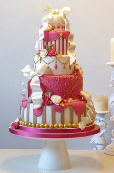 """""""Dark pink and gold colors on this wedding cake make it very elegant. Ohhhh change the colors to red and black."""""""