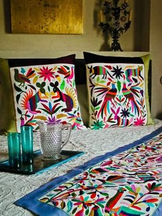 Mexican decor: Mexican tenangos as cushions and table runners. Lightens up a room.