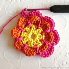Flower tutorial. -- would make a cute pot holder (or rather, a teapot-handle holder)