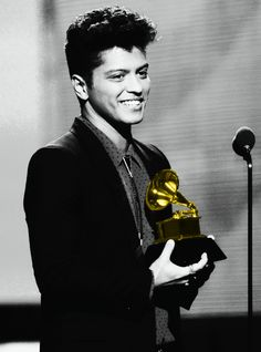 Bruno Mars receiving his second Grammy for his sophomore album, Unorthodox Jukebox