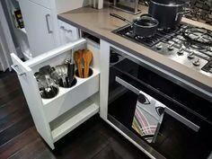 Coming utensils hidden next to stove. Brilliant.