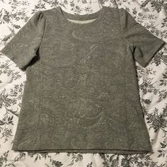 Gray fitted top This is a feminine fitted gray too with capped sleeves from LOFT. It is a sweatshirt like material. LOFT Tops
