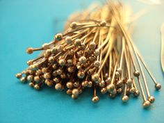 Antique Copper Headpins with Ball 2 inches 22 guage. $1.95, via Etsy.