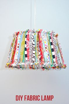 DIY hanging lamp. With the colour scheme if the room - I want to do this in our bedroom with wooden sticks on the frame!!