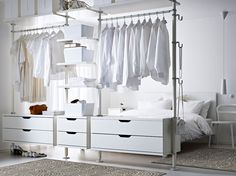 STOLMEN storage solution with drawers, shelves and clothes rails all in white