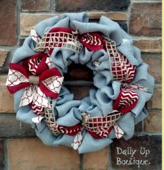 "As 4th of July draws closer we are seeing many wreaths dedicated to the occasions. This unique Burlap Wreath is a favorite for me giving us the 4th of July  feel without being tacky and over done this wreath was not designed for 4th of July but this 20"" wreath with a $39.00 price tag is a fun new way to celebrate the holiday and can stay up far past the 4th."