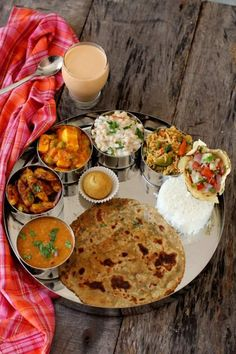 masala paratha recipe, an Indian flat bread made with whole wheat flour, ghee (vegans can use oil), Indian spice powders and herbs like coriander and mint #paratha