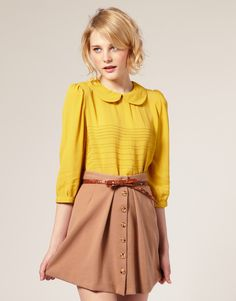 tucked in blouse with peter pan collar. brave yellow.... not for most complexions, I think.