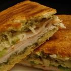 "Chicken Pesto Paninis:  ""A delicious mix of chicken, pesto, veggies, and cheese all melted together on flavorful focaccia bread. Simple, fast, and very tasty - a nice change from normal sandwiches."""