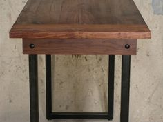 Walnut Kitchen Table with Ebony Details and a Blackened Steel Base