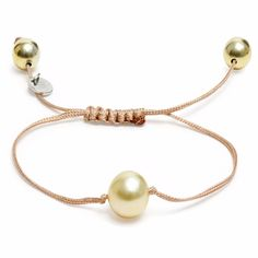 This bracelet is pure, precious beauty One single golden South Sea pearl 10 mm pearl diameter Two gold plated silver beads Gold/ nude nylon cord Nylon drawstring fastening 15DegreesLondon pieces are made from natural materials and therefore may differ from that pictured. The Golden Eye is our gold nugget and as minimalistic as it is, it looks stunning. It is all about the pearl and just skin. You don´t need more. Wear it to every occasion you like.