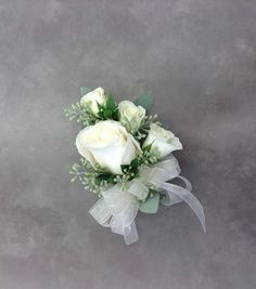 White rose corsage with seeded eucalyptus by Nancy at Belton Hyvee.