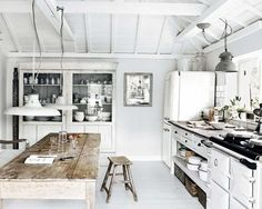 Not fully committed to rustic?Use a farmhouse table instead of kitchen island to create a nice textural contrast in your kitchen