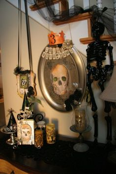 Like the mirror and the witch hats on stands. Love the black tulle on the stairs. Would be great with my orange lights.
