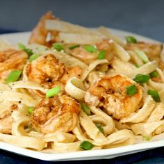 Kick up the weeknight dinner routine with this easy (and cheesy! Incredibly creamy and offering a mouthwatering Cajun kick this just-spicy-enough pasta dish delivers major flavor with minimal effort. Fettucine Alfredo, Pasta Alfredo, Chicken And Shrimp Alfredo, Fettucini Alfredo Recipe Shrimp, Shrimp Broccoli Alfredo, Recipe Alfredo, Cajun Shrimp Pasta, Prawn Dishes, Pasta Dishes