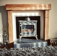 Solid oak beam fire surround from the finest rustic air dried oak beams. Oak beam mantel and 2 legs. Fitting kit included