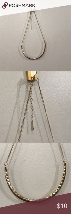 Gold curved bar necklace Simple gold curved bar necklace. Wore once to a wedding but I'd definitely be able to wear it to work. Accessorize Jewelry Necklaces