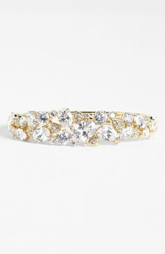 Free shipping and returns on Nadri Cubic Zirconia Cluster Bangle (Nordstrom Exclusive) at Nordstrom.com. Magnetic sparkle unites the clustered-crystal setting topping a polished bangle.