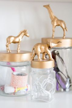 """Pick up some little toys from the dollar store, glue them to jar lids, and <a href=""""http://sayehpezeshki.com/amanda-risiuss-bright-diy-home-office-studio-space/"""" target=""""_blank"""">paint them</a> to give your desk storage a facelift."""