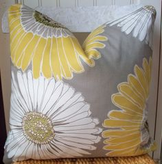 Grey and yellow floral pillow