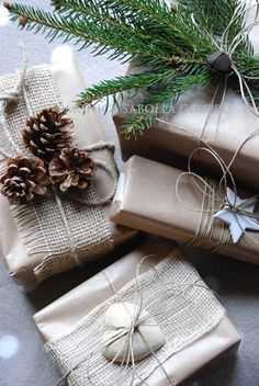 33 Adorable Burlap Christmas Gifts Wrapping Ideas!!! Bebe'!!! Burlap ribbon and natural rustic accents like pine cones, wooden cutouts and string!!!