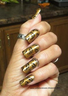 Lovely gold and black swirl manicure on Diane Gaham's custom-fit nails!