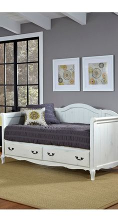 Daybeds are quaint and charming, and this white country-style wood is no exception.