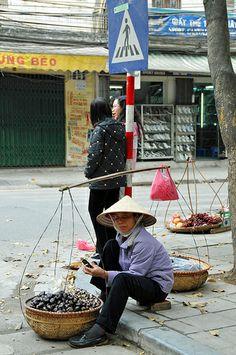 street vendor removing the snail meat to sell, Hanoi, Vietnam