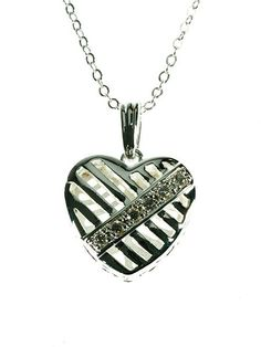 Indulgence Silver plated heart pendant with crystal stones. Silver plated Heart Pendant with Six Crystal Stones.
