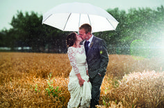 Bride and groom kissing in the cornfields in the rain, near to Curradine Barns. 15 Outdoor Wedding Photo Ideas at Curradine Barns