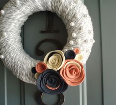 Yarn and felt wreath, How to link:  http://midwesternmoms.com/2011/12/yarn-wreath-with-felt-flower-tutorial/    After basics, add some flair with pearls, glitter, flowers, bows, or anything you want!