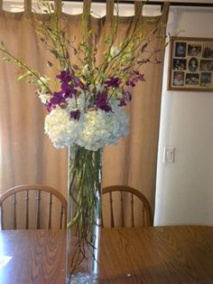 large white vase with white and purple orchids - Bing Images