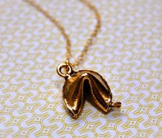 fortune cookie necklace, it would be better if this had a zipper and you could put in a new fortune everyday!!