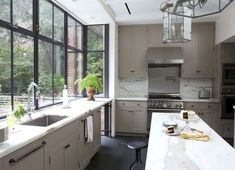 Brooklyn kitchen // marble counters & backsplash with neutral tan cabinets #homedecor #interiordesign